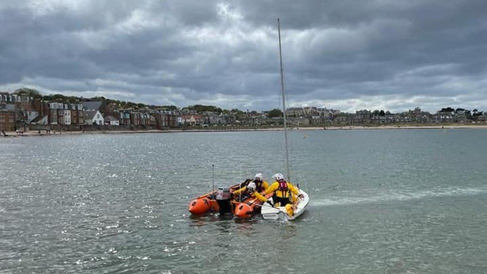 Eight rescued from dinghy and paddleboards