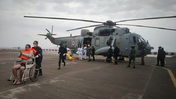 Indian navy searches for 77 missing from barge sunk by cyclone