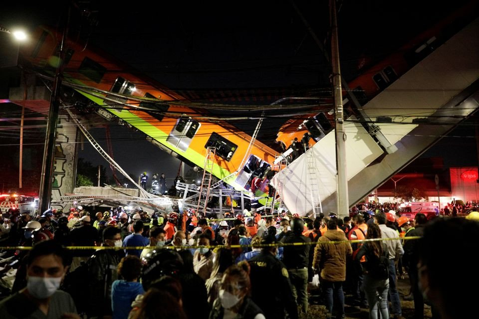 Mexico City rail overpass collapses onto road killing 20 people